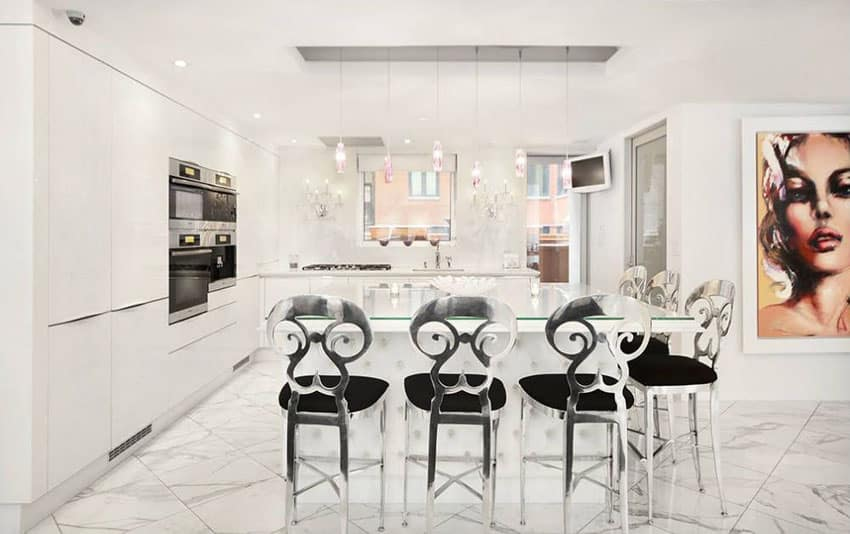 White modern kitchen with porcelain floor tiles and modern pendant lamps