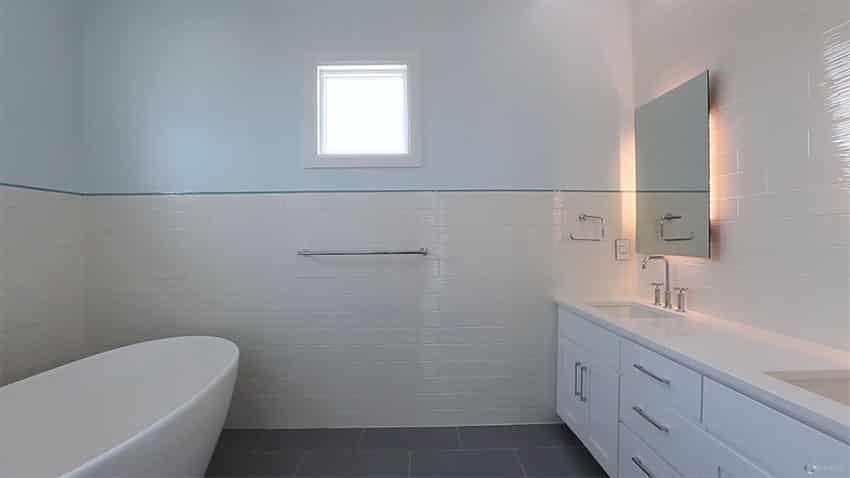 White tiled bathroom at oceanfront house