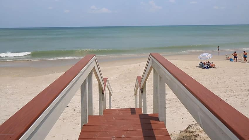 Wood walkway to beach access from house