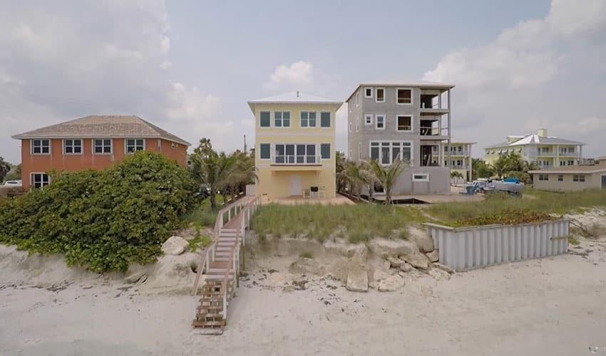 Yellow beach house with ocean access