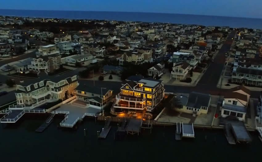 4 story home on water at night
