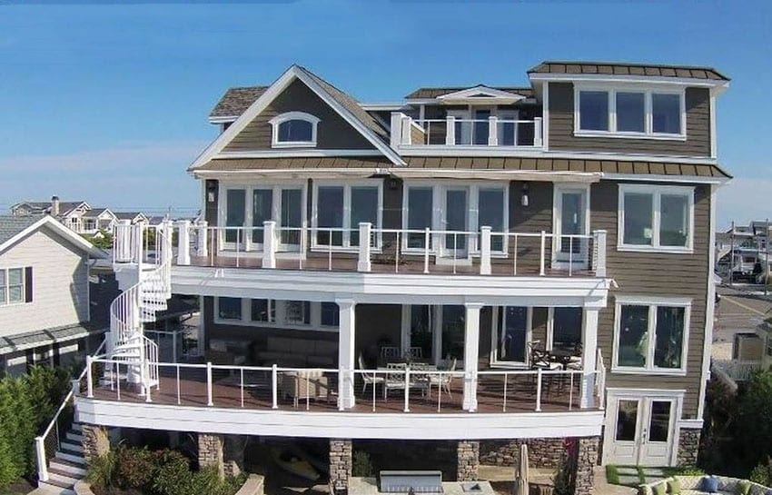 4 story house on water with viewing decks