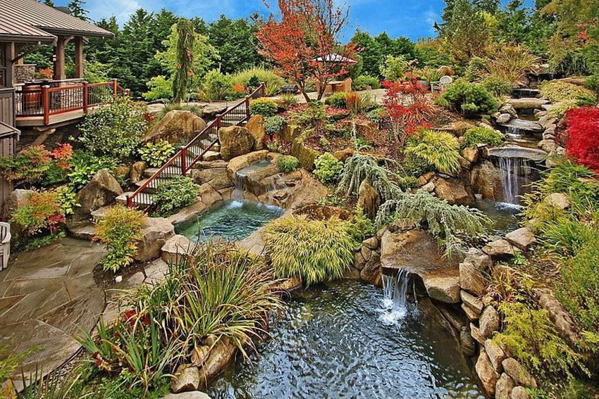 Asian garden with river water feature flowing to pond