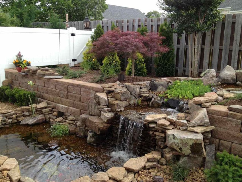 Backyard waterfall over paver retaining wall