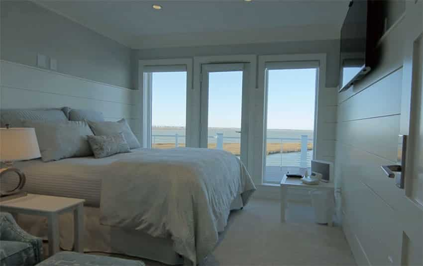 Beautiful bedroom with elevated waterfront views