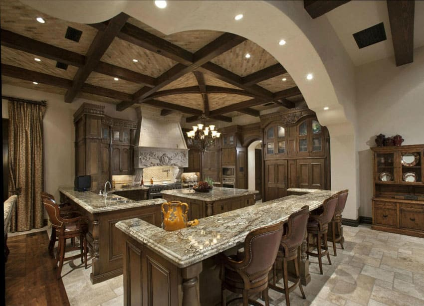 Beautiful luxury kitchen with long dining island limestone floors