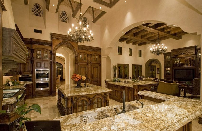 Beautiful Mediterranean kitchen with high ceilings yellow river granite counters