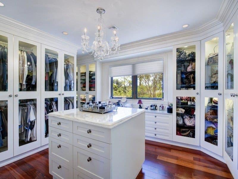 Beautiful walk in closet with carrara marble island