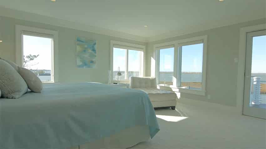 Bright bedroom with waterfront estuary views