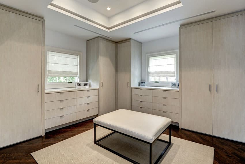 Contemporary walk in closet with ottoman and engineered maple floors