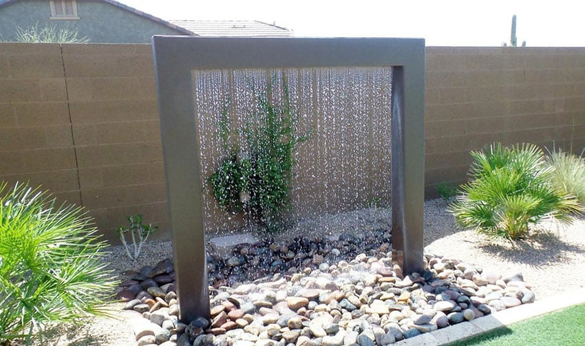 Contemporary waterfall rain shower in backyard