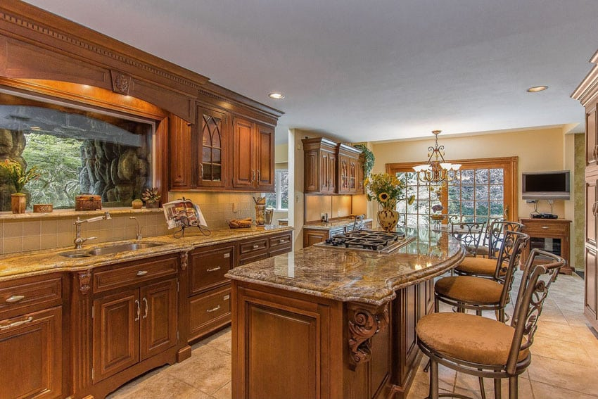 Craftsman kitchen with breakfast bar island and travertine floors