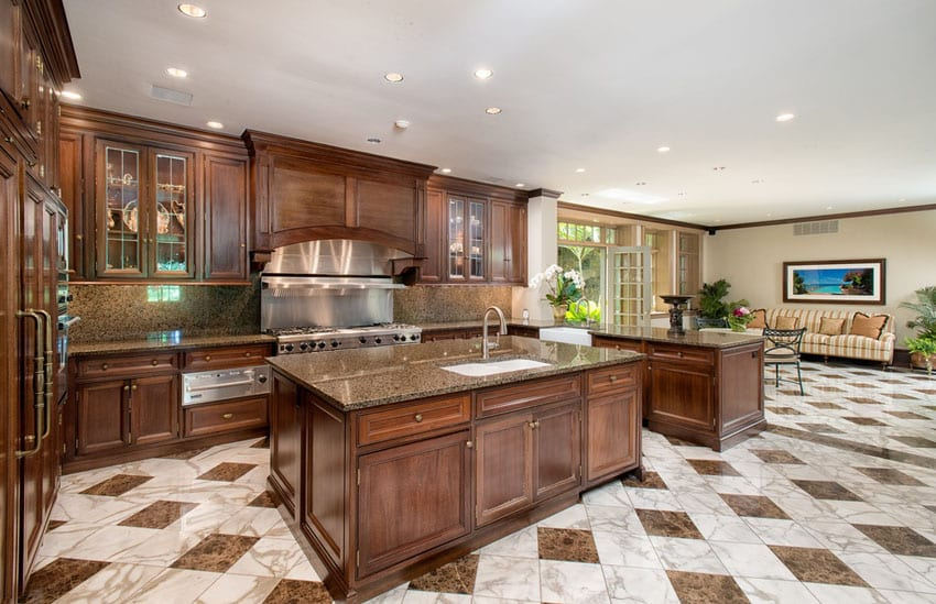 Craftsman kitchen with brown granite counter and marble tile flooring