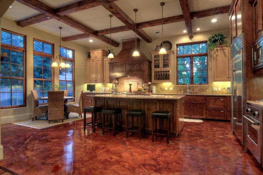 Craftsman kitchen with concrete floors and pendant lights