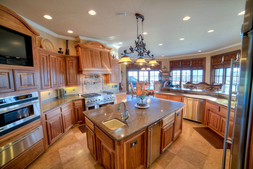 Craftsman kitchen with custom hood and cabinets with granite counters