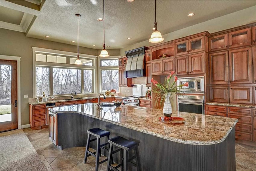 Craftsman kitchen with large island with cream granite and porcelain flooring