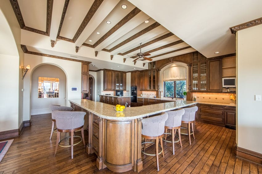 Craftsman kitchen with long l-shaped breakfast bar island