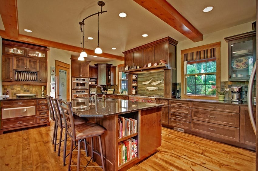 Craftsman kitchen with pine floors and wrought iron pendant lights
