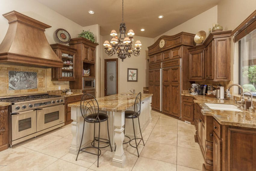 Craftsman kitchen with travertine floors and light granite counter