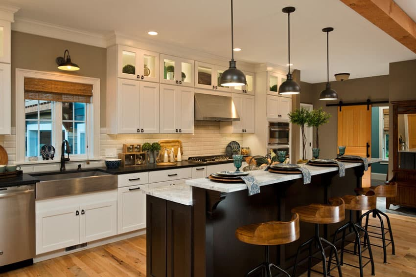 Craftsman kitchen with white cabinets and hardwood flooring