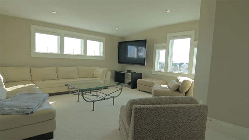 Cream color living room with large sectional couch
