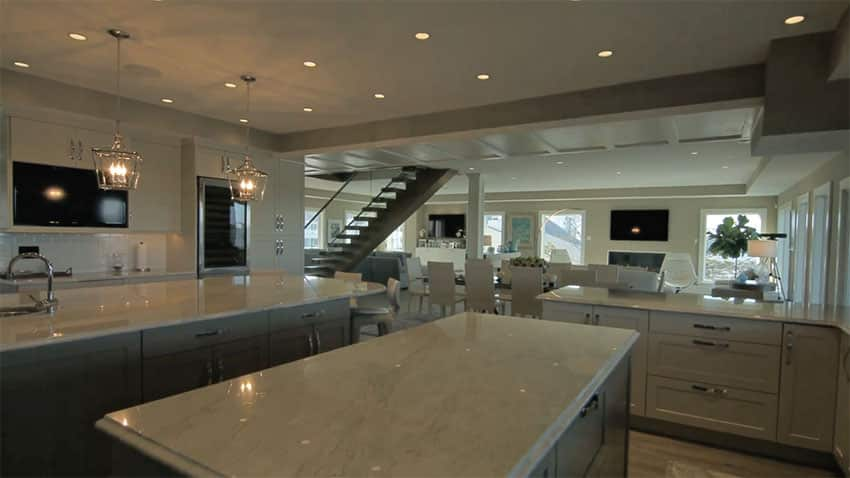 Custom gourmet kitchen with white cabinets
