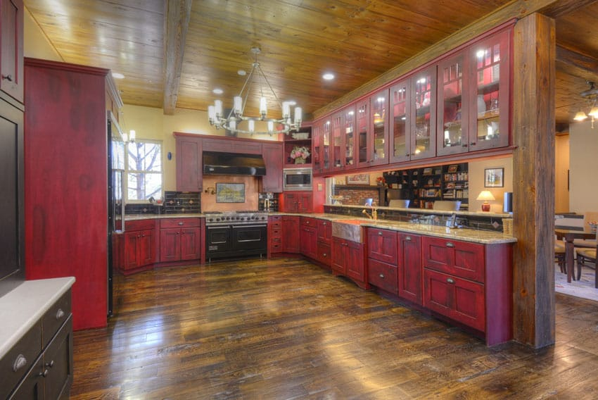 Custom kitchen with rich wood flooring and high ceiling