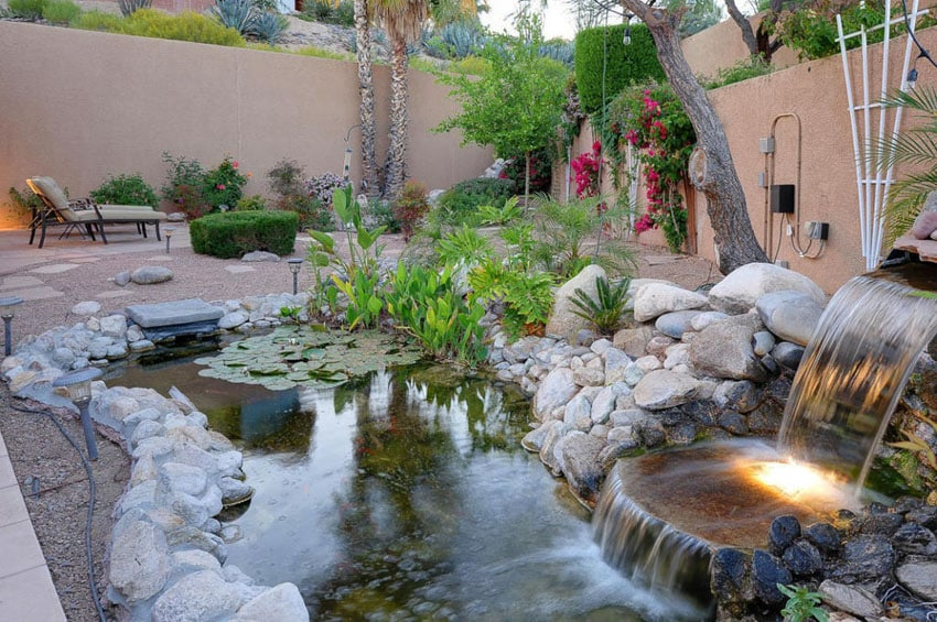 Custom pond and waterfall in backyard