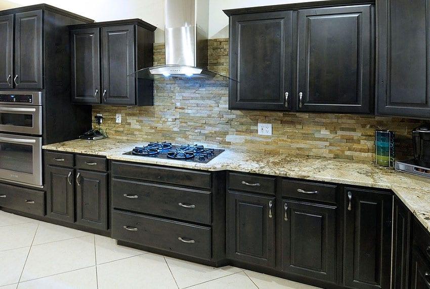 Dark cabinet kitchen with quartz backsplash tile