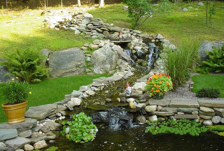 Garden with stone stream and small waterfalls