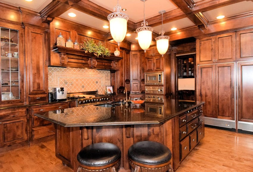 Kitchen with custom cabinetry and coffered ceiling