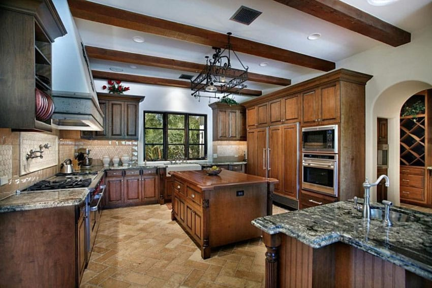 Kitchen with green granite counters and butcher block island