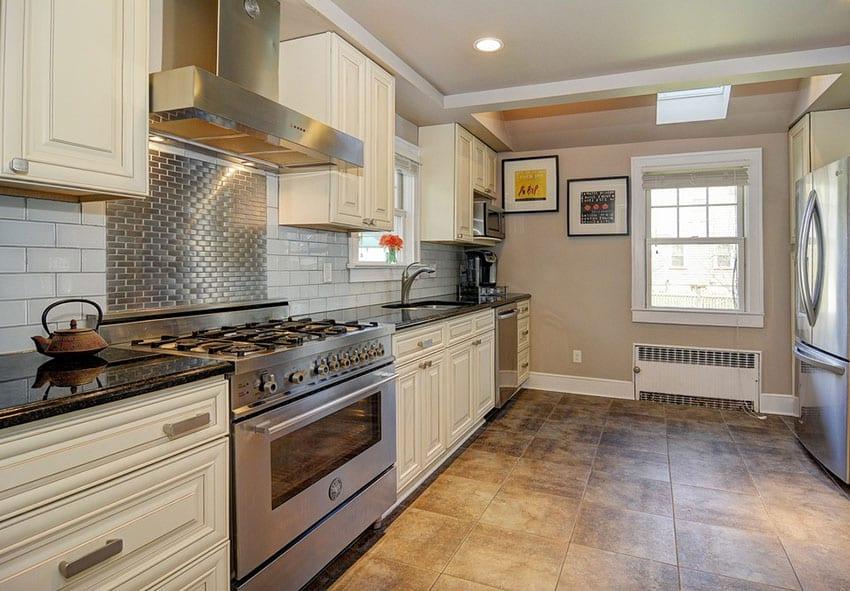 Kitchen with subway tile backsplash and stainless steel backsplash