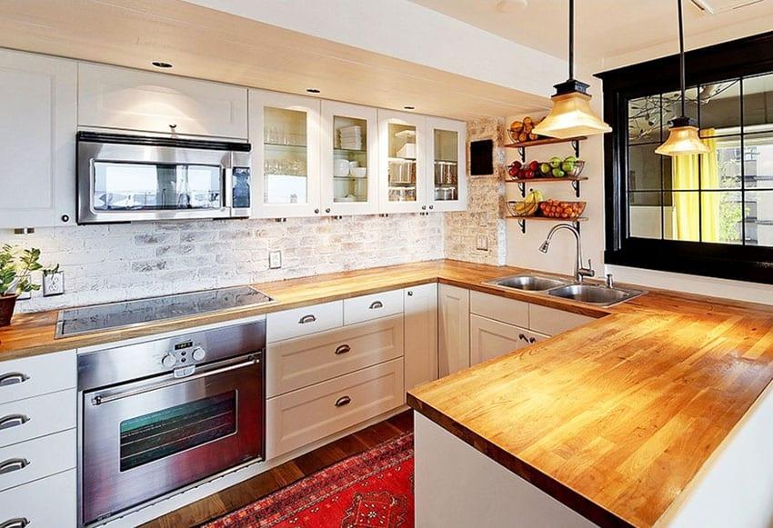 Kitchen with thin clay brick backsplash with white-washed finish