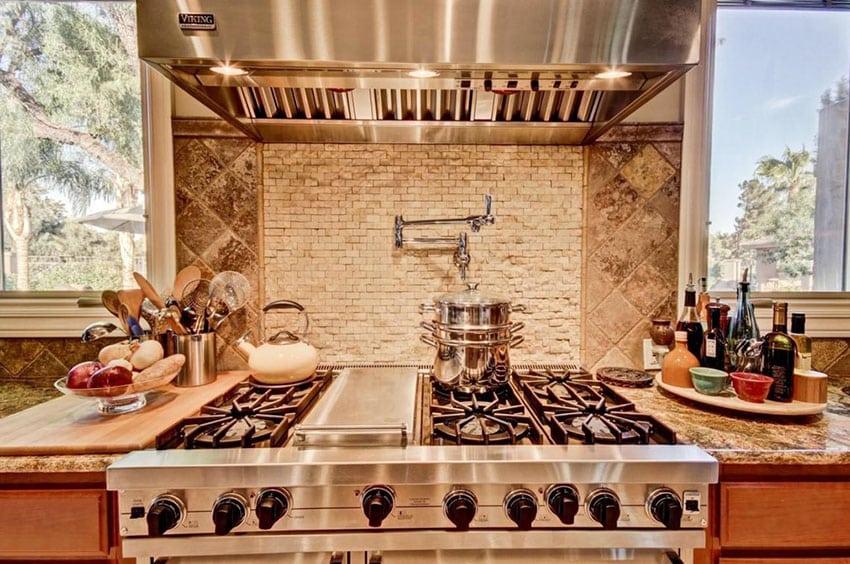 Kitchen with travertine mosaic tile backsplash