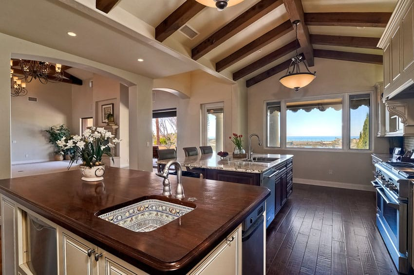 Kitchen with vaulted ceiling and dark wood flooring