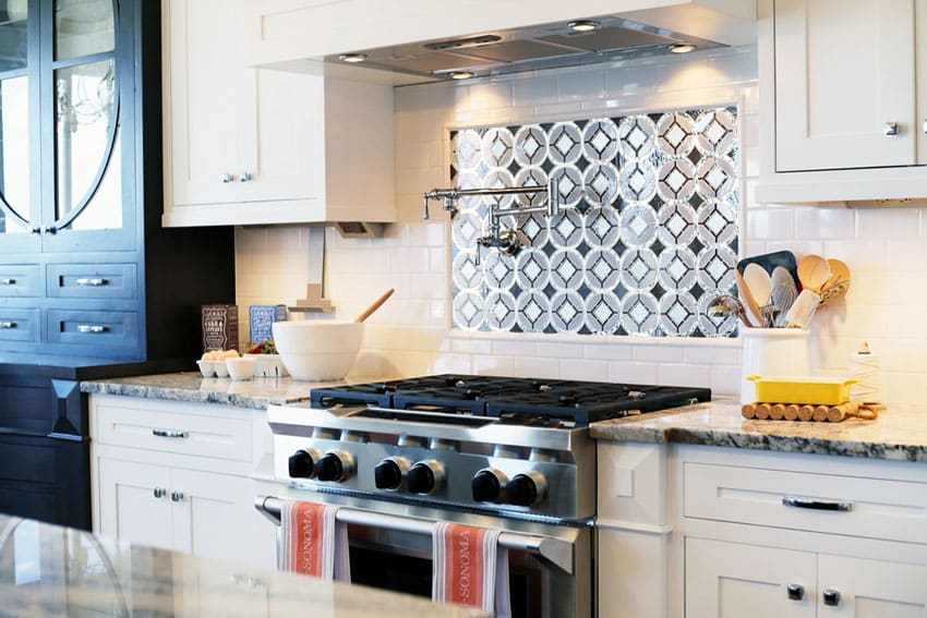 Kitchen with white subway tile backsplash and inset tile above range