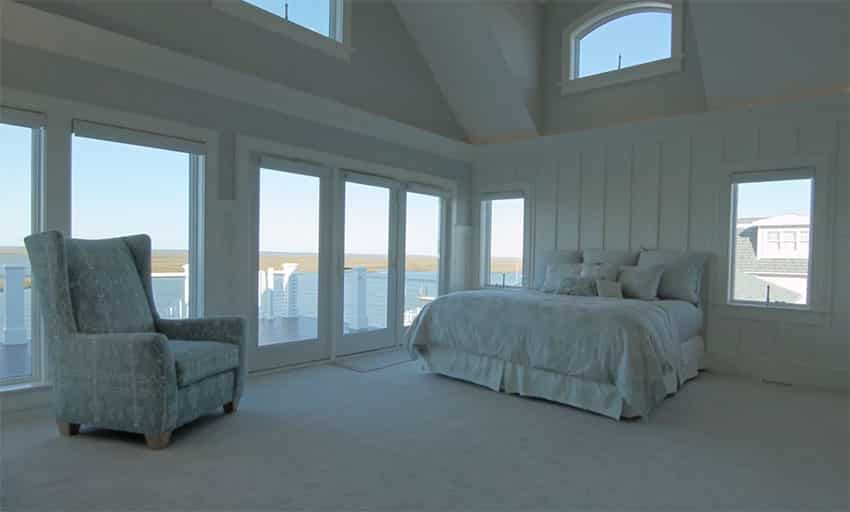 Large master bedroom with bay views balcony and high ceilings