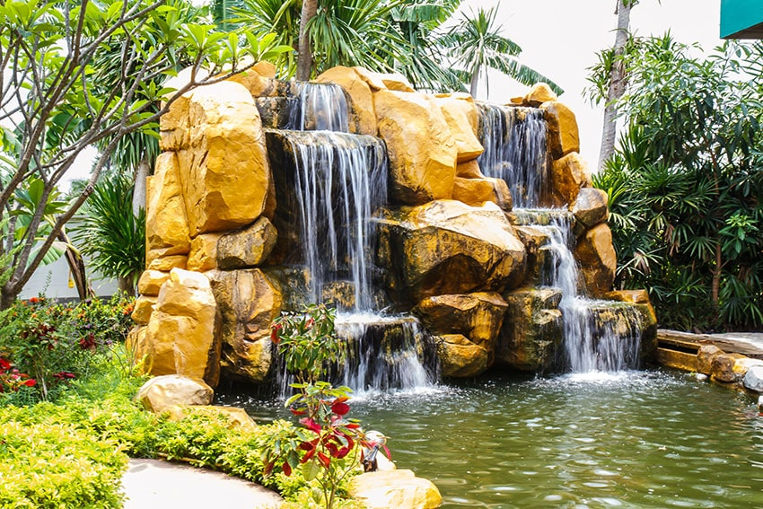 Large double sided rock waterfall in garden