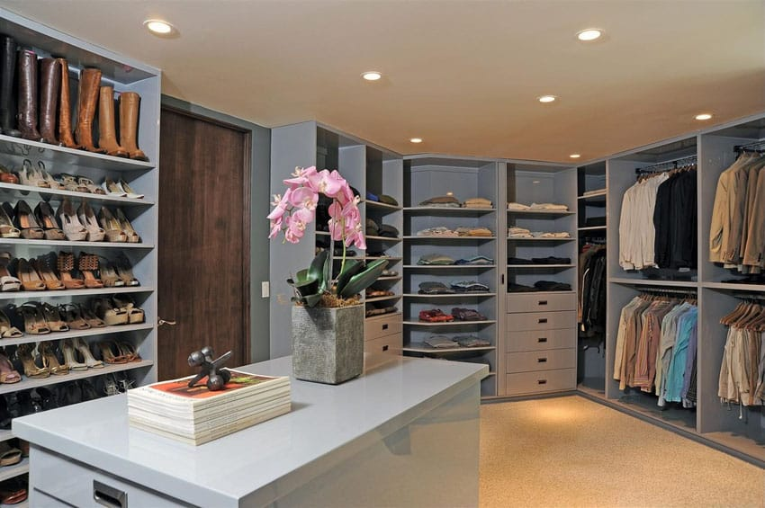 Light blue laminate walk in closet with island