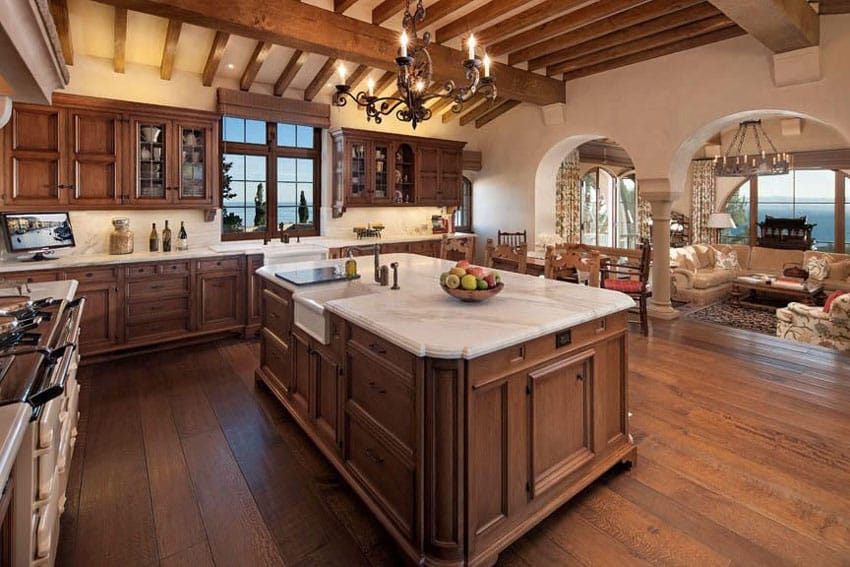 Luxury craftsman kitchen with farmhouse sink and wood beam ceiling