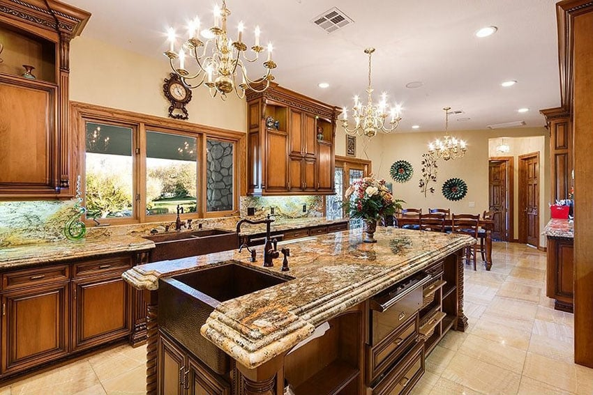 Luxury kitchen with limestone flooring and granite counters