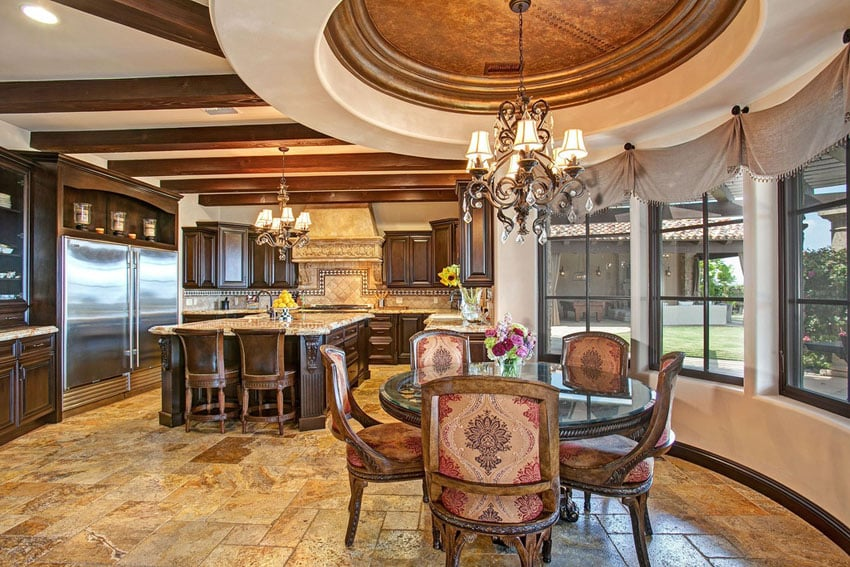 Luxury Mediterranean kitchen with gold travertine floors and cupola dining room
