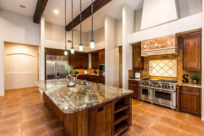 Mediterranean kitchen with azurite granite countertop and mini pendant lights