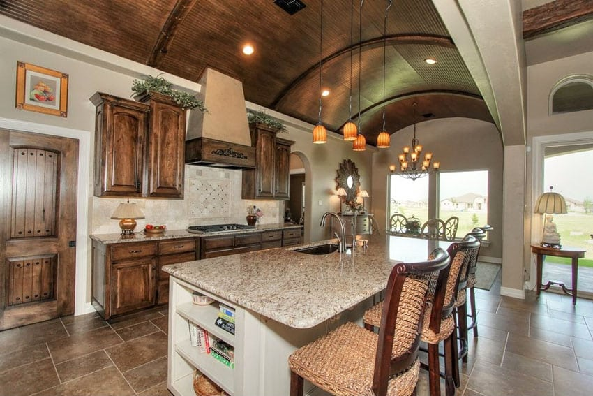Mediterranean kitchen with blanco tulum granite counter arched wood ceilings
