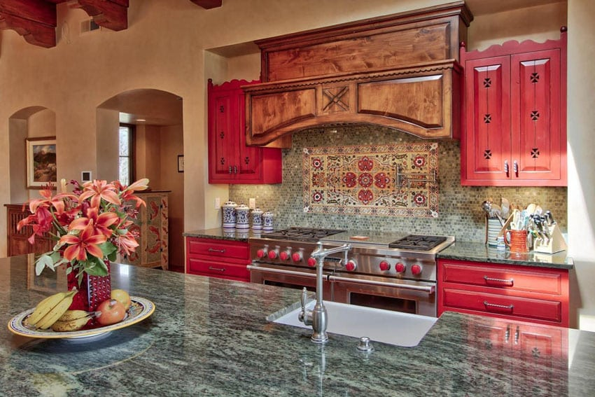 Mediterranean kitchen with coastal gray quartz countertop and red cabinets