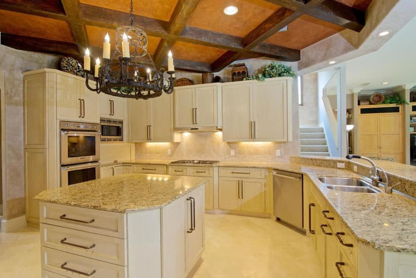 Mediterranean kitchen with cream cabinets and giallo ornamental granite counter