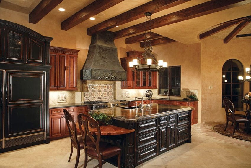 Mediterranean kitchen with dark cabinets island travertine floors and marble counters