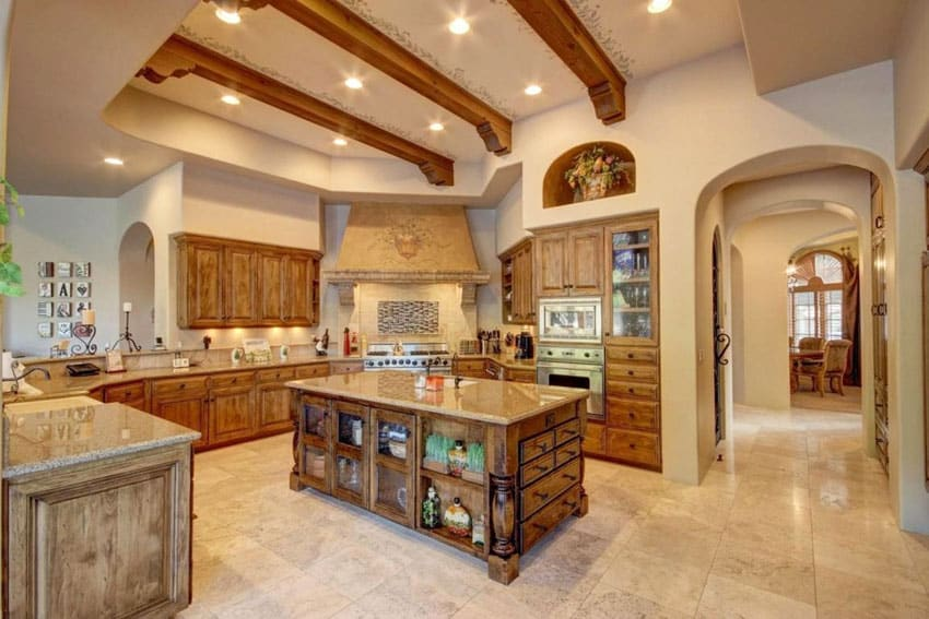 Mediterranean kitchen with exposed beam ceilings travertine floor tiles