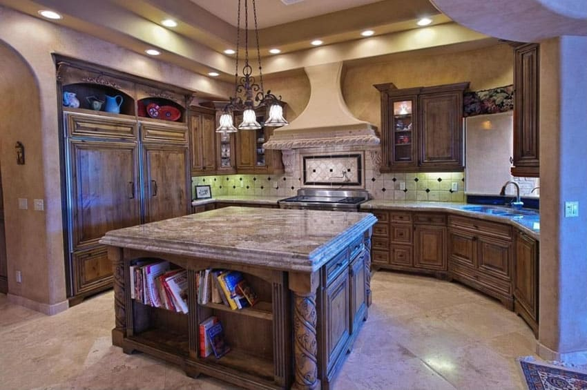Mediterranean kitchen with golden bordeaux granite counters raised panel cabinetry